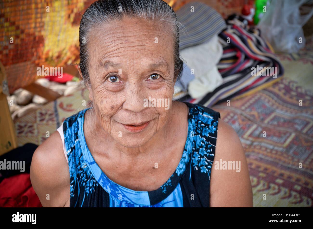 Laotian woman at a market, Luang Prabang, Laos - Stock Image