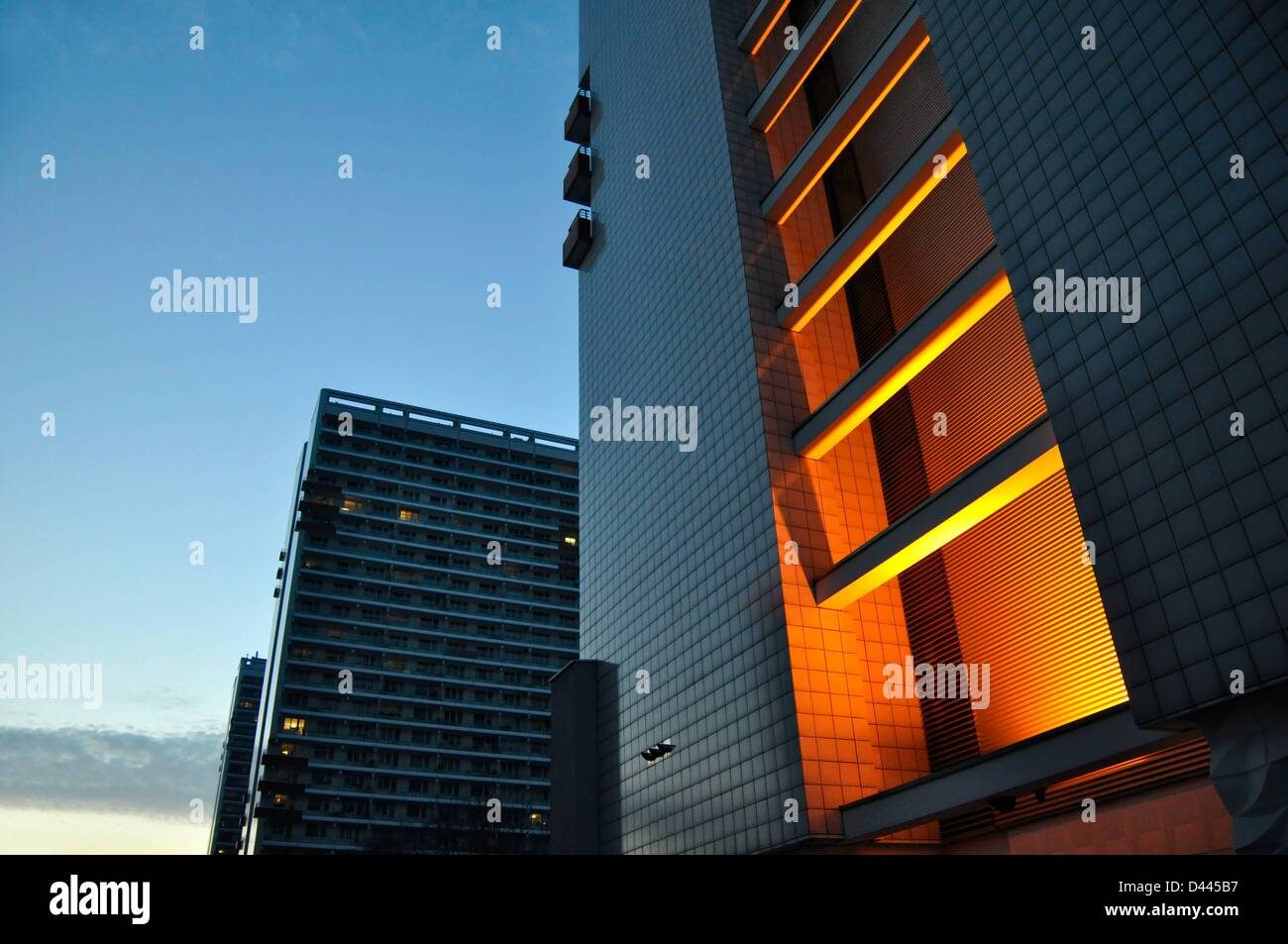 The illuminated front of a skyscraper during the blue hour in Leipziger Strasse in Berlin, Germany, 24 February - Stock Image