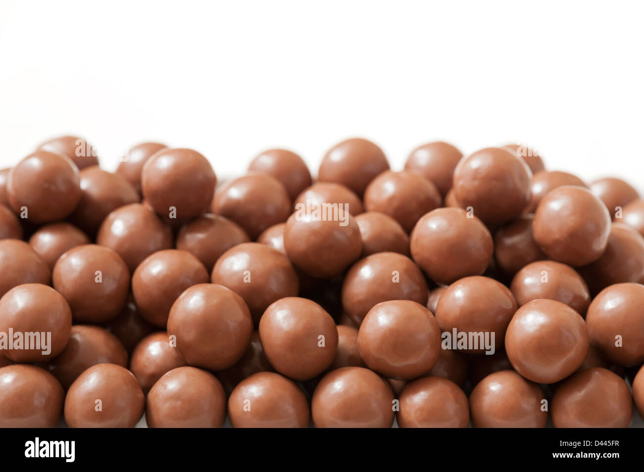 Close up of chocolate balls - Maltesers - against a white background - Stock Image