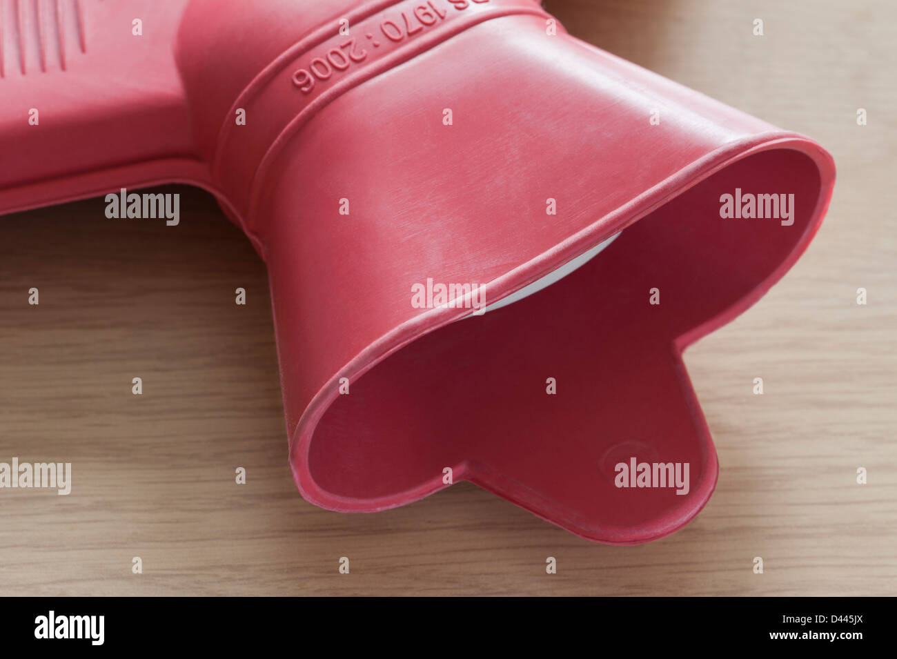 Pink rubber hot water bottle close up Stock Photo