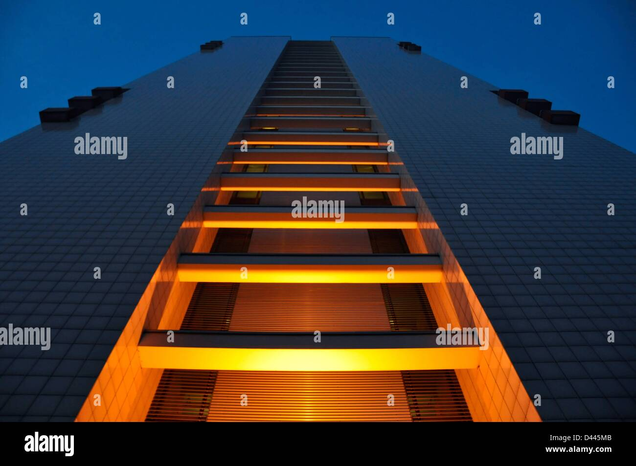 The illumanted front of a skyscraper during the blue hour in Leipziger Strasse in Berlin, Germany, 24 February 2011. - Stock Image