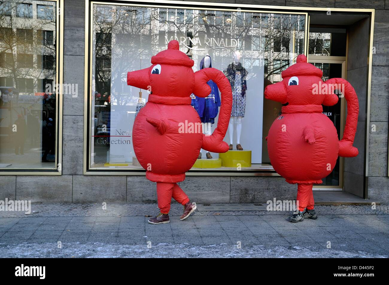 The German supermarkt chain Kaiser's Tengelmann advertises with two promoters wearing red coffee pots on Kurfürstendamm - Stock Image