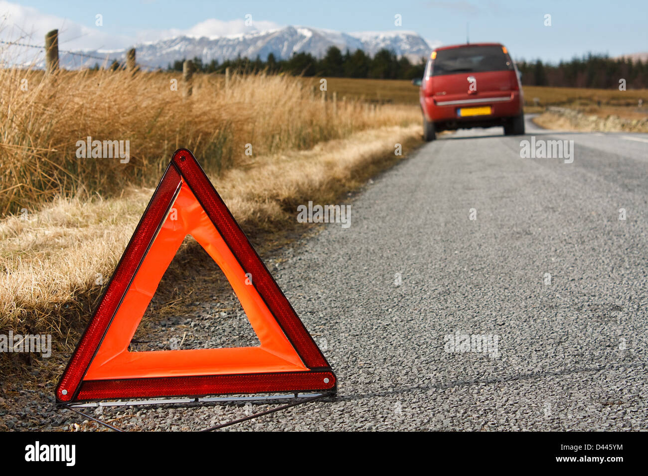 car awaiting recovery after experiencing a breakdown in a remote countryside location in the great outdoors - Stock Image