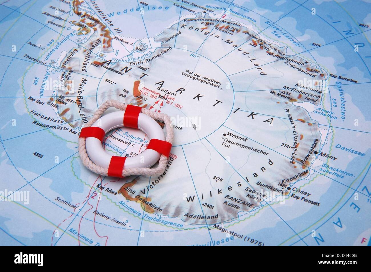 Illustration - A miniature safety buoy is pictured lieing on the south pole of a world map in Berlin, Germany, 22 December 2007. Photo: Berliner Verlag/S.Steinach Stock Photo