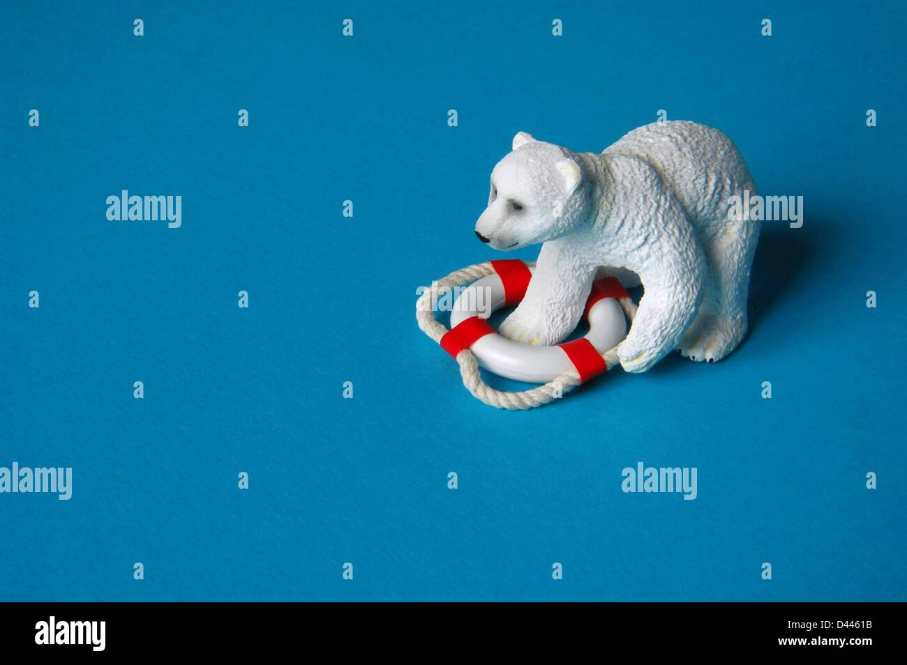 Illustration - A miniature polar bear is pictured with one of his paws inside of a safety buoy in Berlin, Germany, 25 December 2007. Photo: Berliner Verlag/S.Steinach Stock Photo