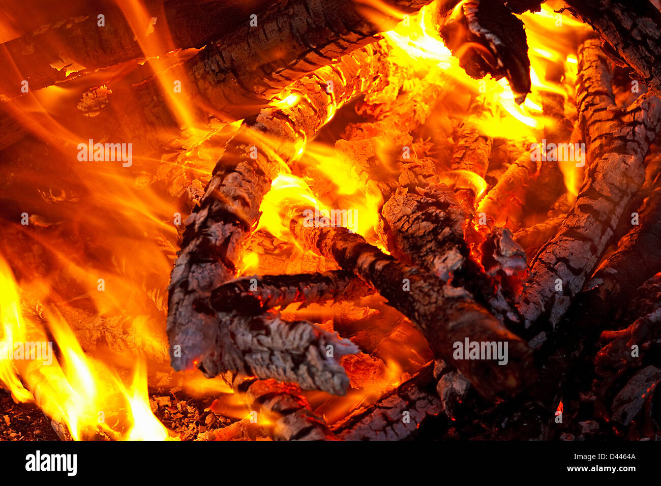 natural wood log fire embers glowing great for background or in solid fuel stoves now classed as a renewable power - Stock Image