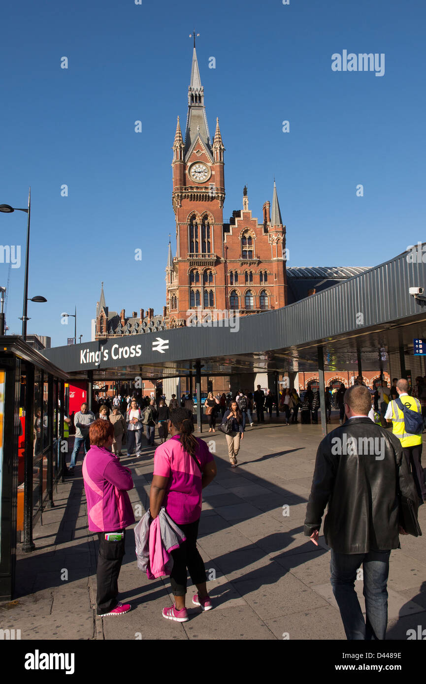 Clock tower of St Pancras International railway station with the entrance to Kings Cross railway station in the - Stock Image