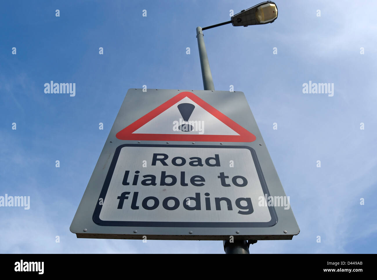 british road liable to flooding road sign with exclamation mark above Stock Photo