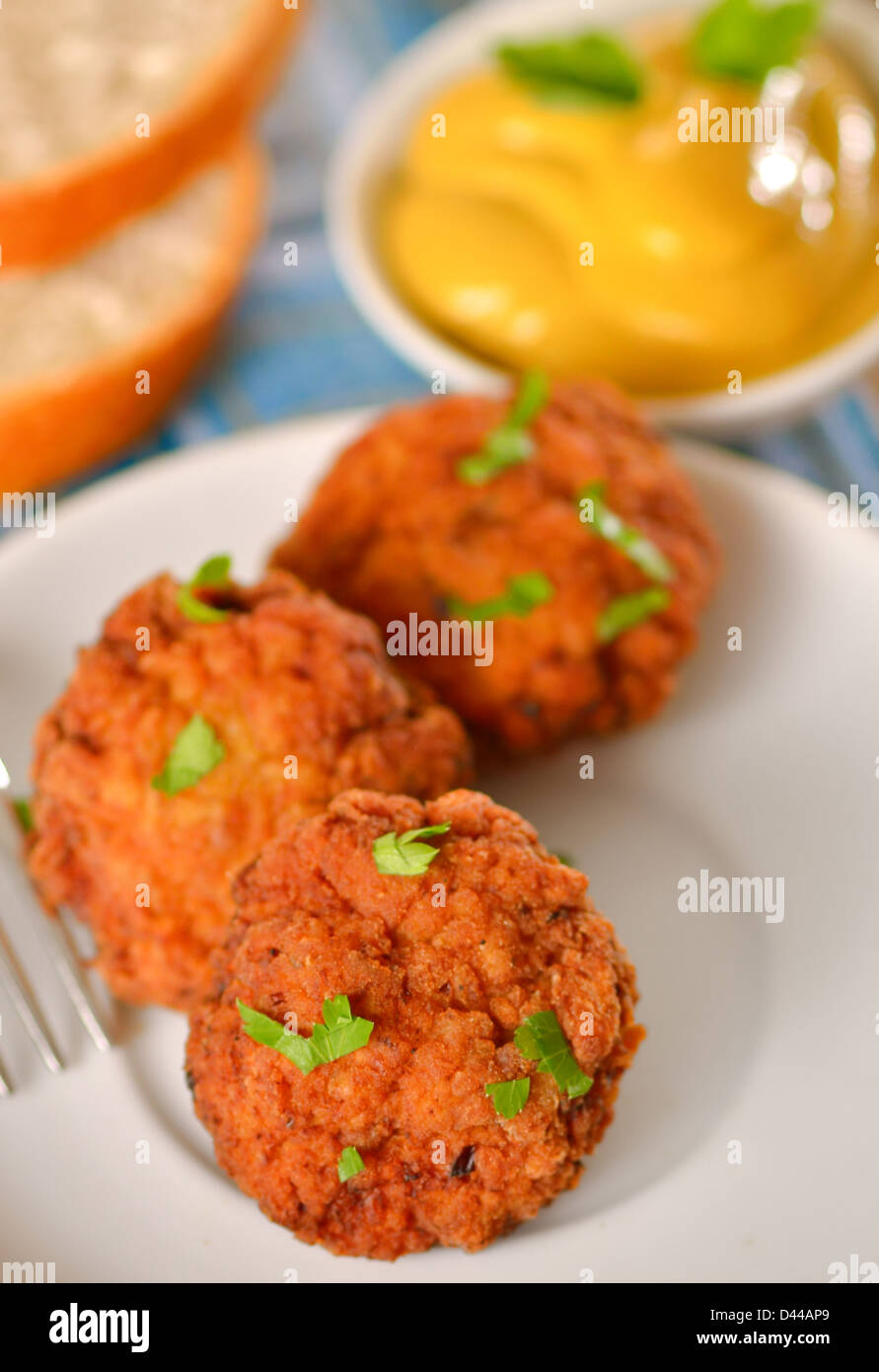 meat balls with mustard on white dish - Stock Image