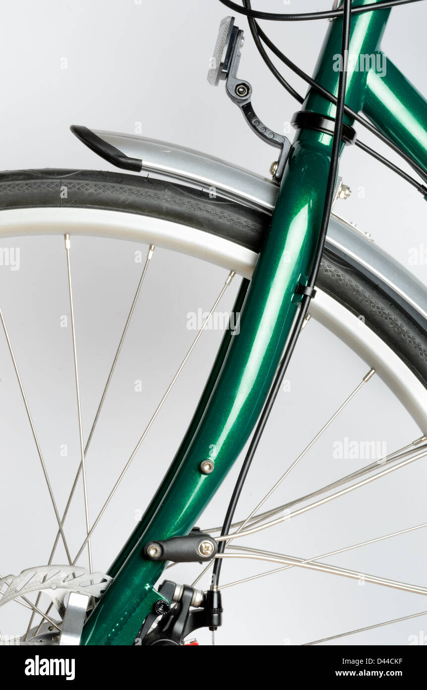 Green touring bicycle isolated on a white background - Stock Image