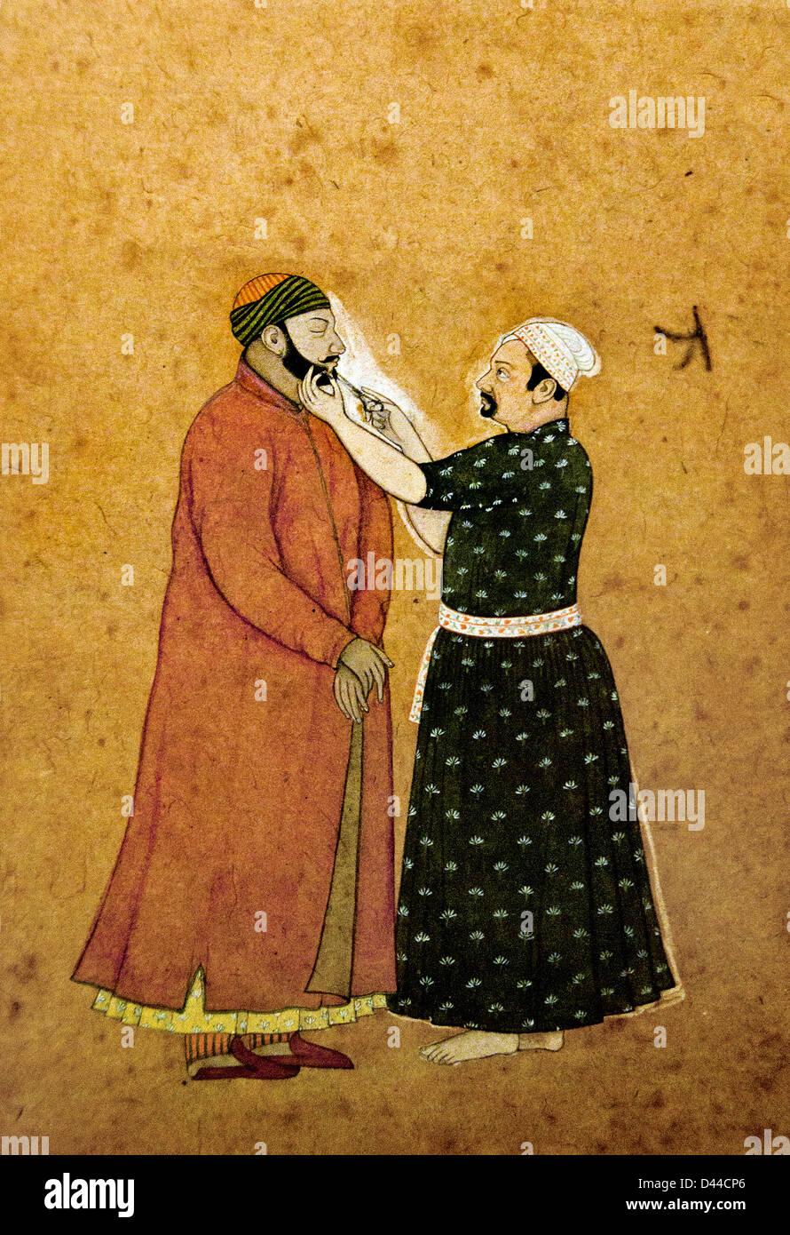 Balwath Singh getting his beard trimmed 1755 Pahari India - Stock Image
