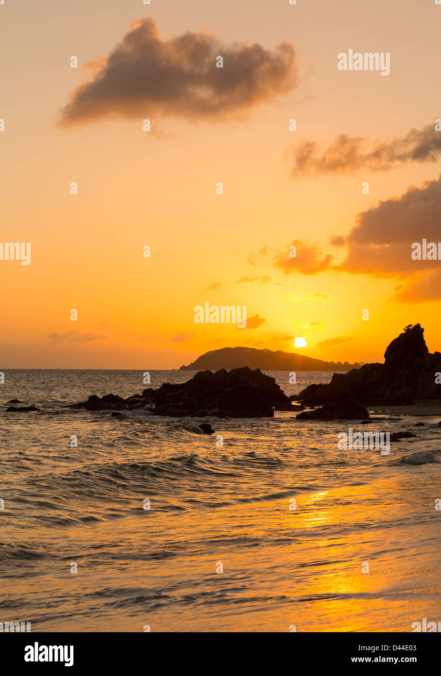 Sun setting over islands by Charlotte Amalie in St Thomas taken from Frenchmans Bay Stock Photo