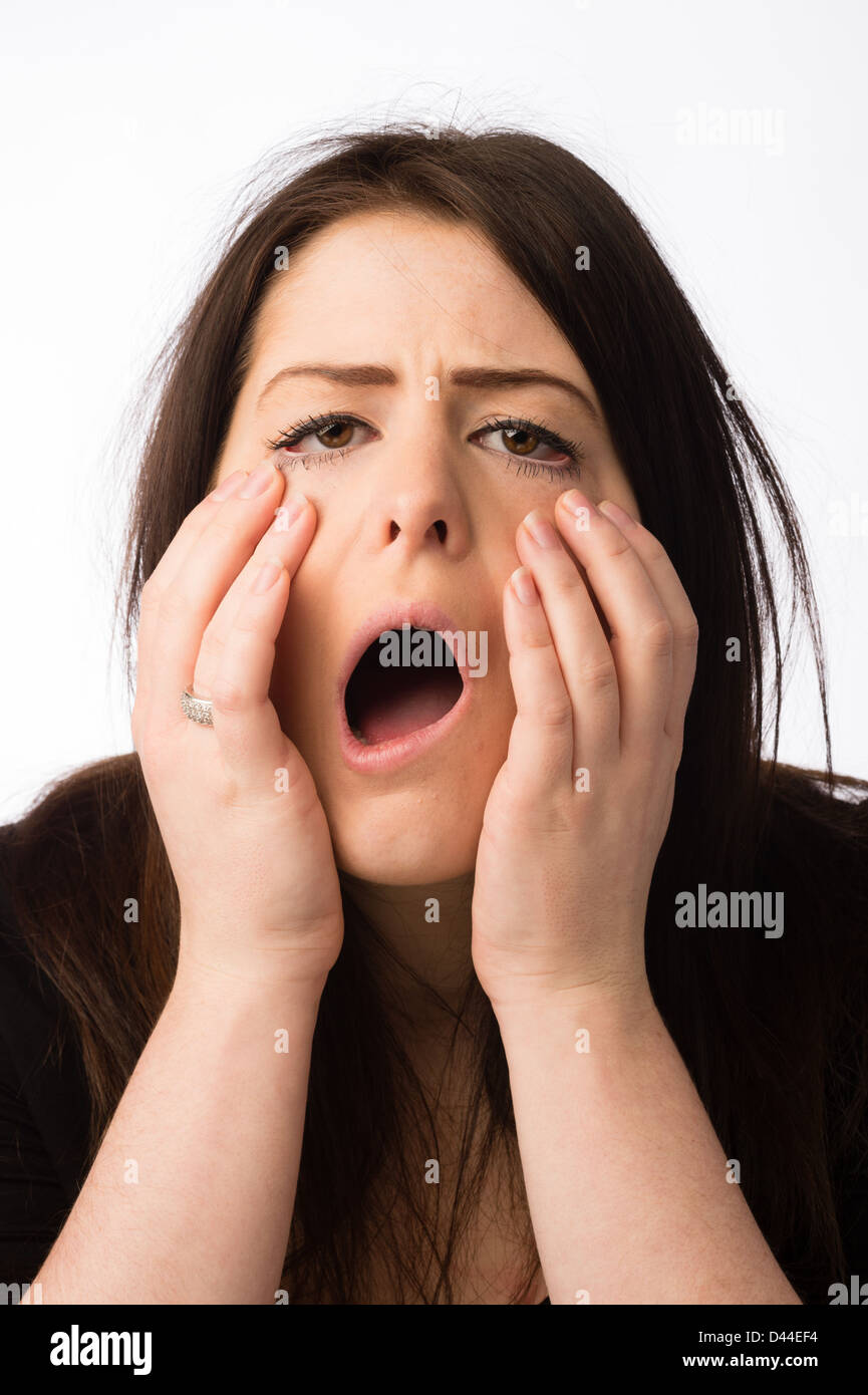 A young ill sick ailing hungover  woman girl female, brown hair, UK - Stock Image
