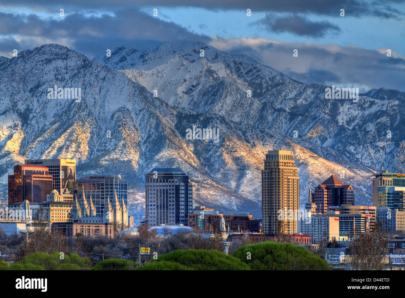 Panoramic view of the downtown Salt Lake City skyline in early spring with the snow capped Wasatch Mountains inStock Photo