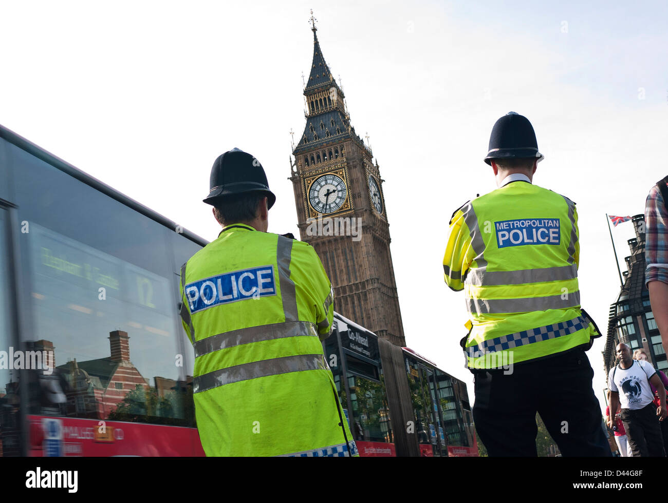 London Police officers wearing helmets and high visibility on Westminster street duty back view at Westminster Bridge Stock Photo