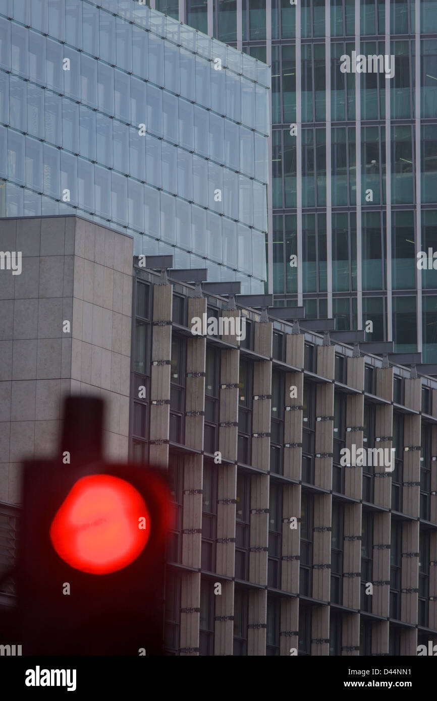 Mixed architecture of generic City of London office buildings and red Stop traffic light in the heart of the capital's - Stock Image