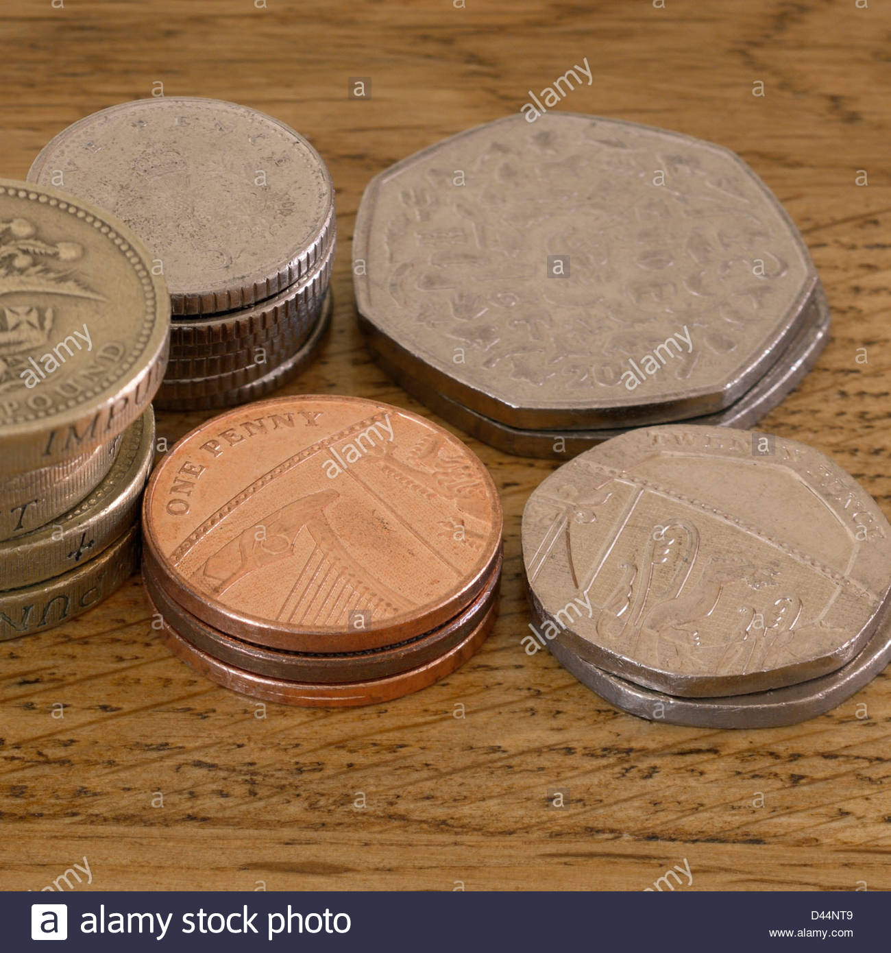 Piled coins on a table Stock Photo