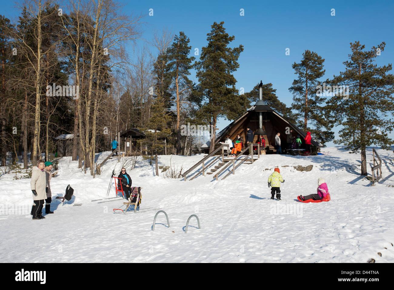 People enjoying sunny weather on the Karhusaari camping site, Lappeenranta Finland - Stock Image
