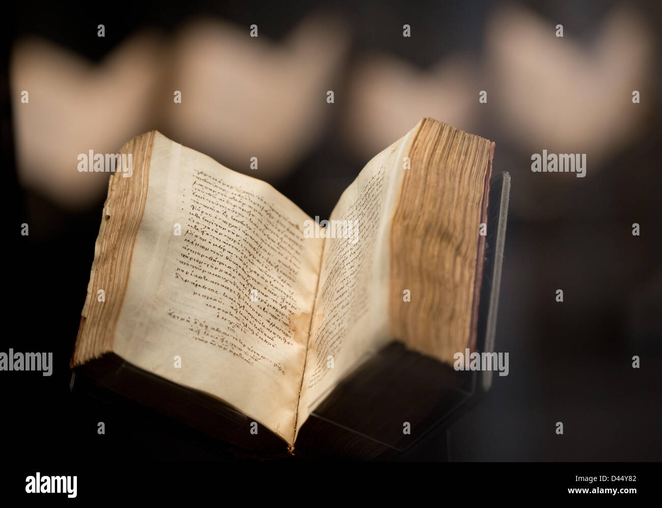 An ancient book containing the sermons of the early Christian theologist Origenes in Greek language is on display - Stock Image