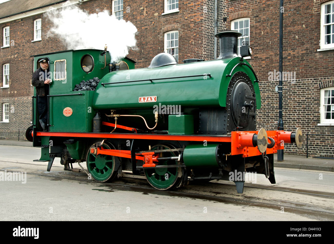 Ajax, Saddle Tank steam locomotive with driver, working at Chatham Historic Dockyard - Stock Image