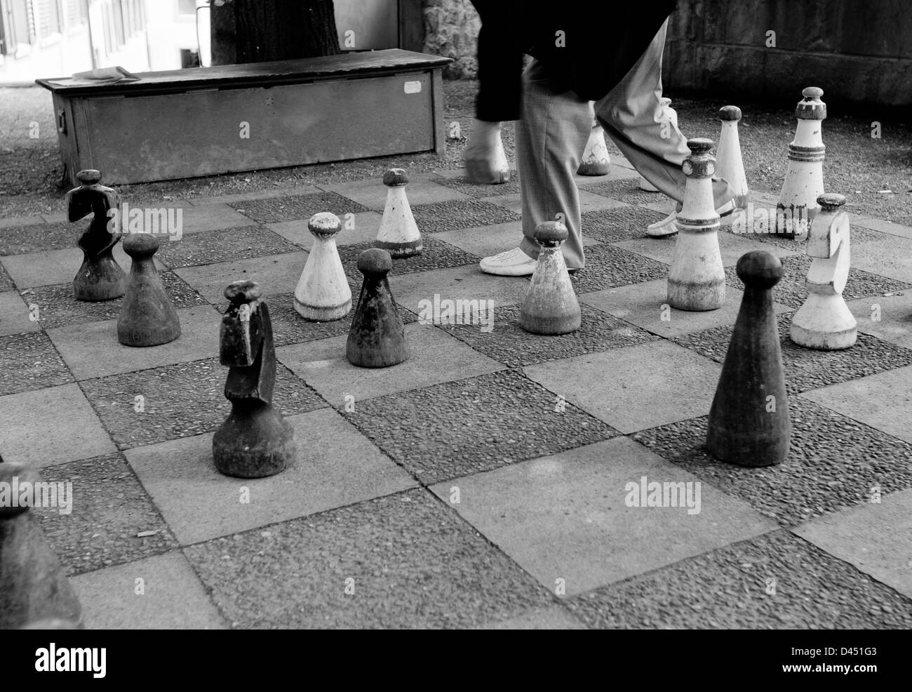 giant chess set in the floor, black and white - Stock Image
