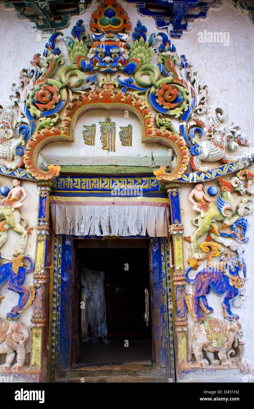 Decoration around entrance to a chapel, Kumbum Chörten, Palcho monastery, Gyantse, Tibet - Stock Image