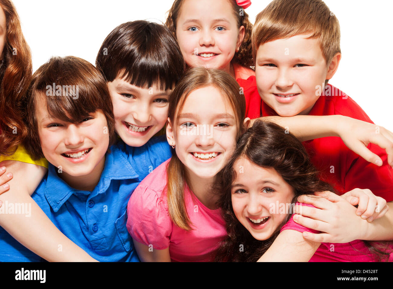 close up of a group of 10 years old kids boys and girls hugging