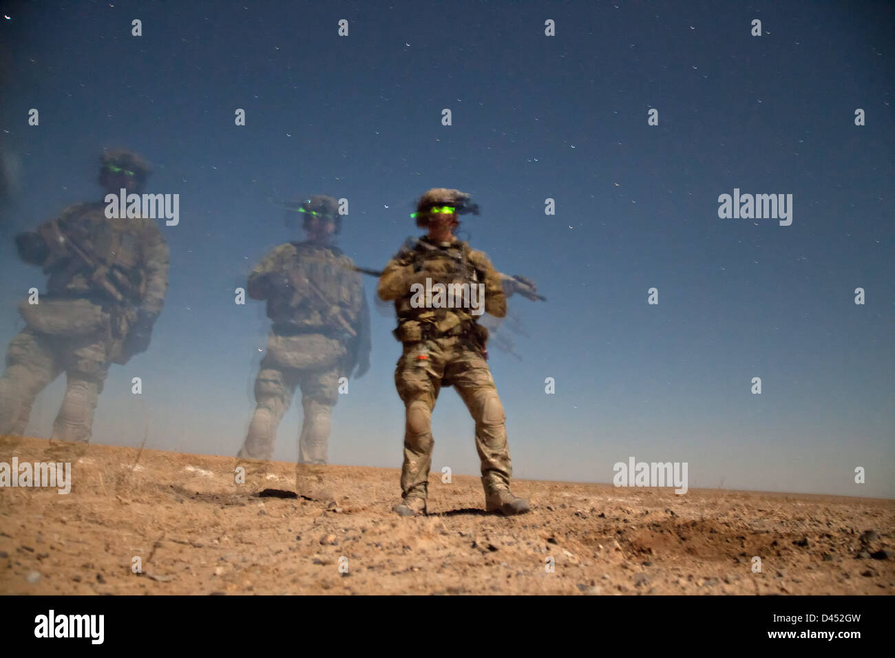 A US Marine shown in a time exposure during a night raid to arrest a presumed Taliban leader January 24, 2013 in - Stock Image
