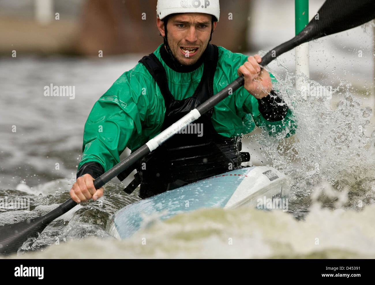 Man Paddling Canoe In Whitewater Rapids Competition
