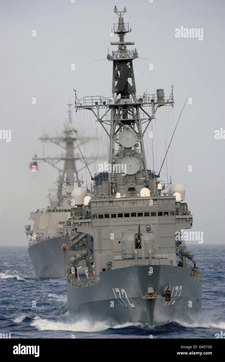 JS Shimakaze (DDG 172) transits in formation with a U.S. Navy ship. Stock Photo