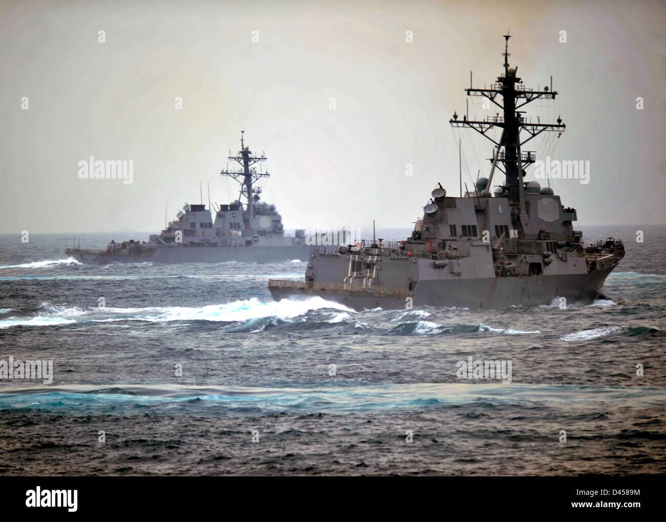 Navy ships perform evasive maneuvers during a simulated strait transit exercise. Stock Photo
