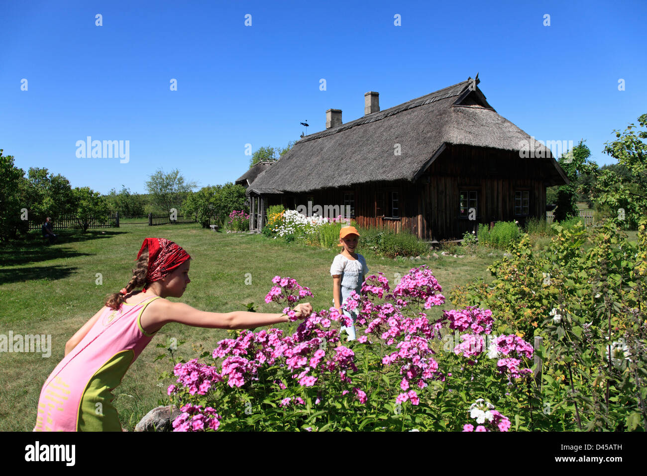 Two girls at Latvian Ethnographic Open-air Museum, near Riga, Latvia - Stock Image