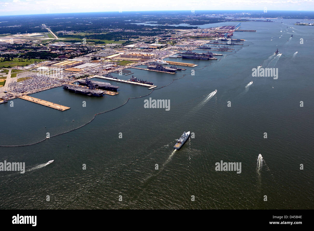 The Naval Station Norfolk waterfront. - Stock Image