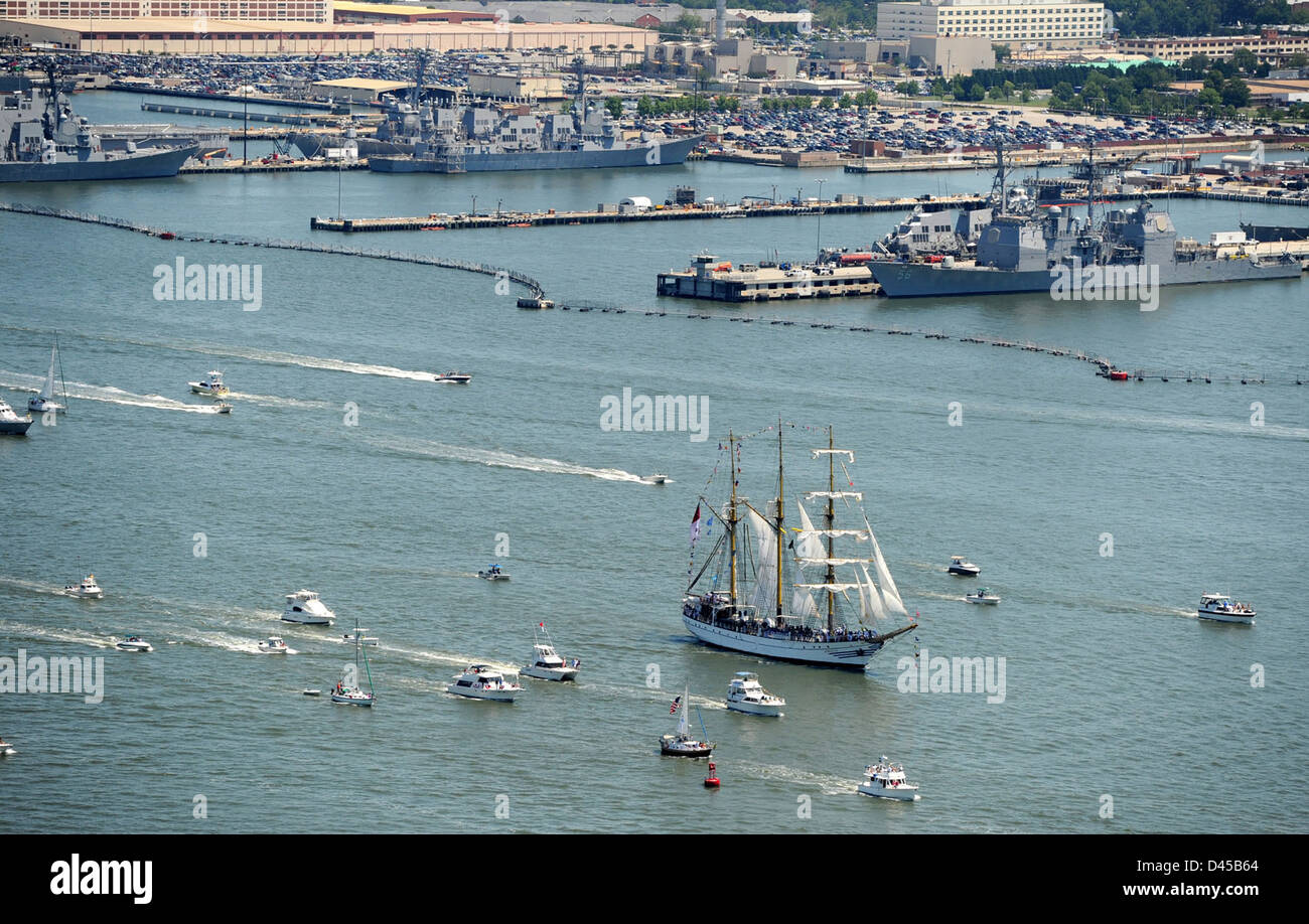 Ships participating in Operation Sail 2012 Virginia sail past Naval Station Norfolk towards the downtown Norfolk - Stock Image