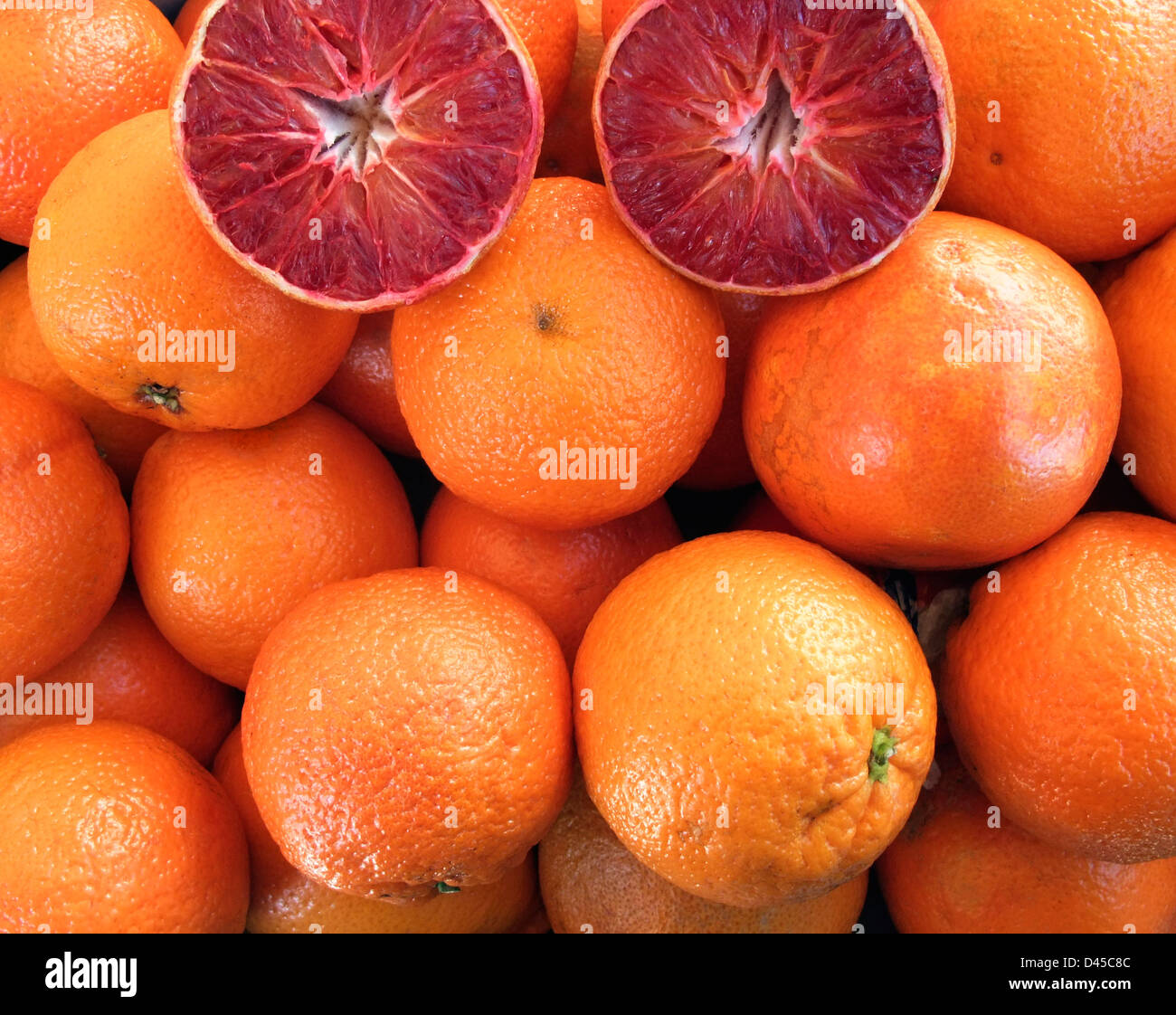 full frame background with lots of blood oranges - Stock Image