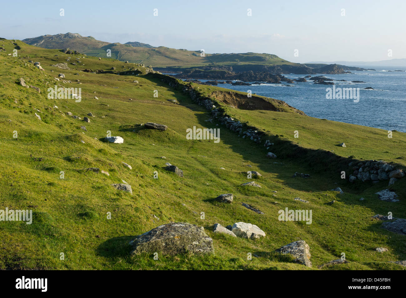 Remnants of stone age fortification on top of cliffs on the rugged coastline of Achill Island, Westport, County - Stock Image