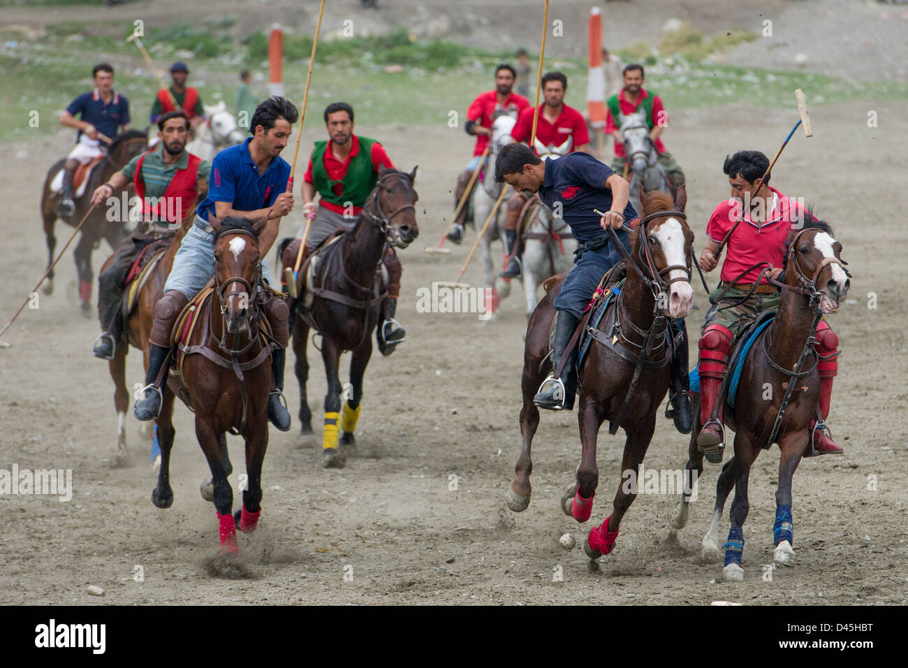 Players making a charge during a polo match, Chitral, Khyber-Pakhtunkhwa, Pakistan - Stock Image