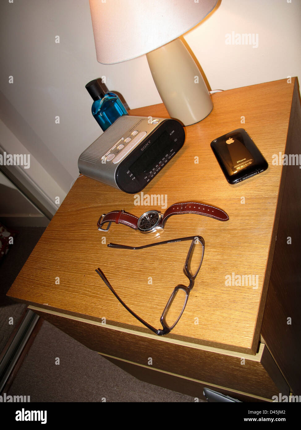 Bedside table with lamp clock radio glasses and iphone stock photo bedside table with lamp clock radio glasses and iphone aloadofball Images