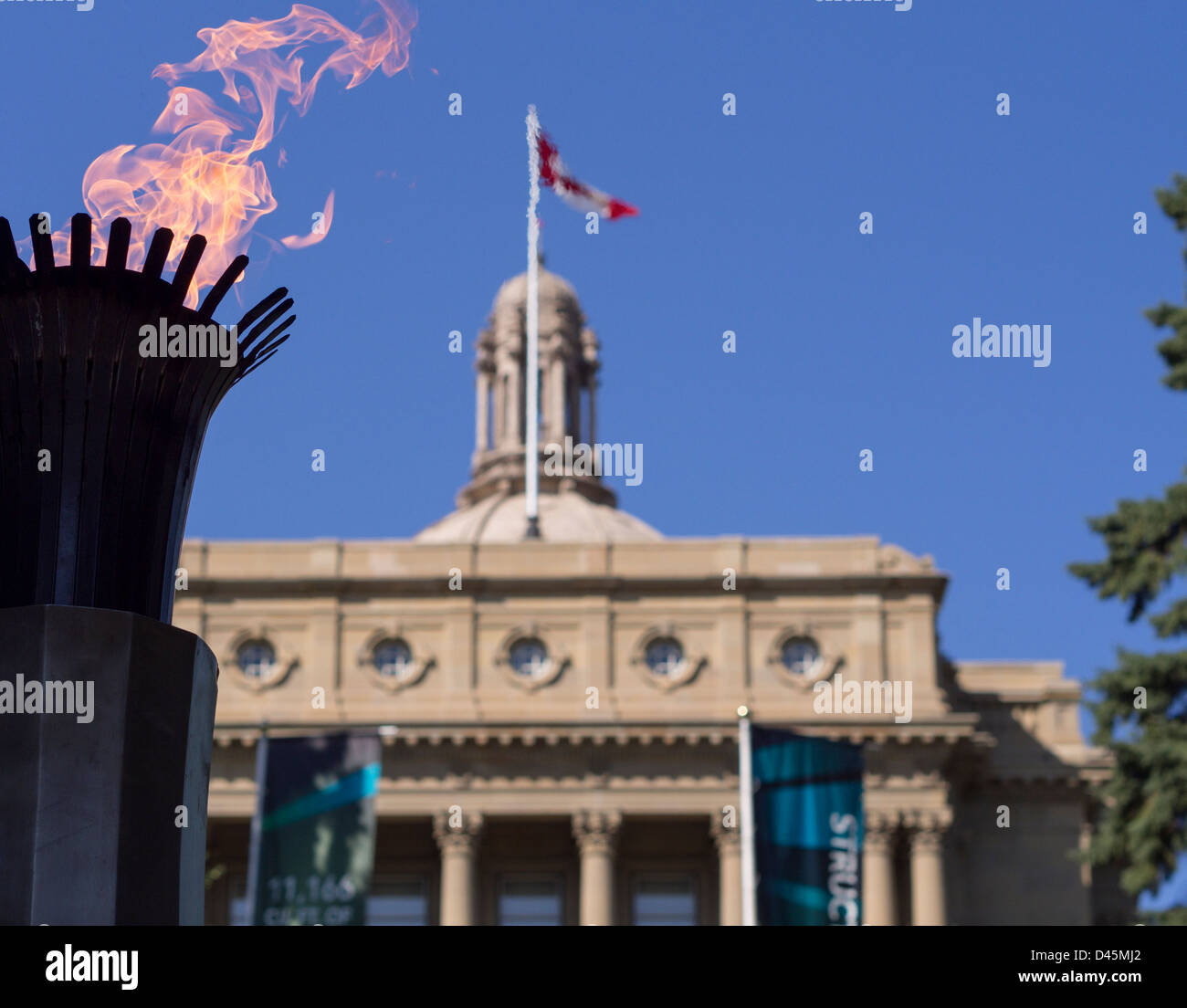 Centennial Flame and the Alberta Legislature. The flames of the 1967 monument honouring 100 years of  Canadian confederation - Stock Image