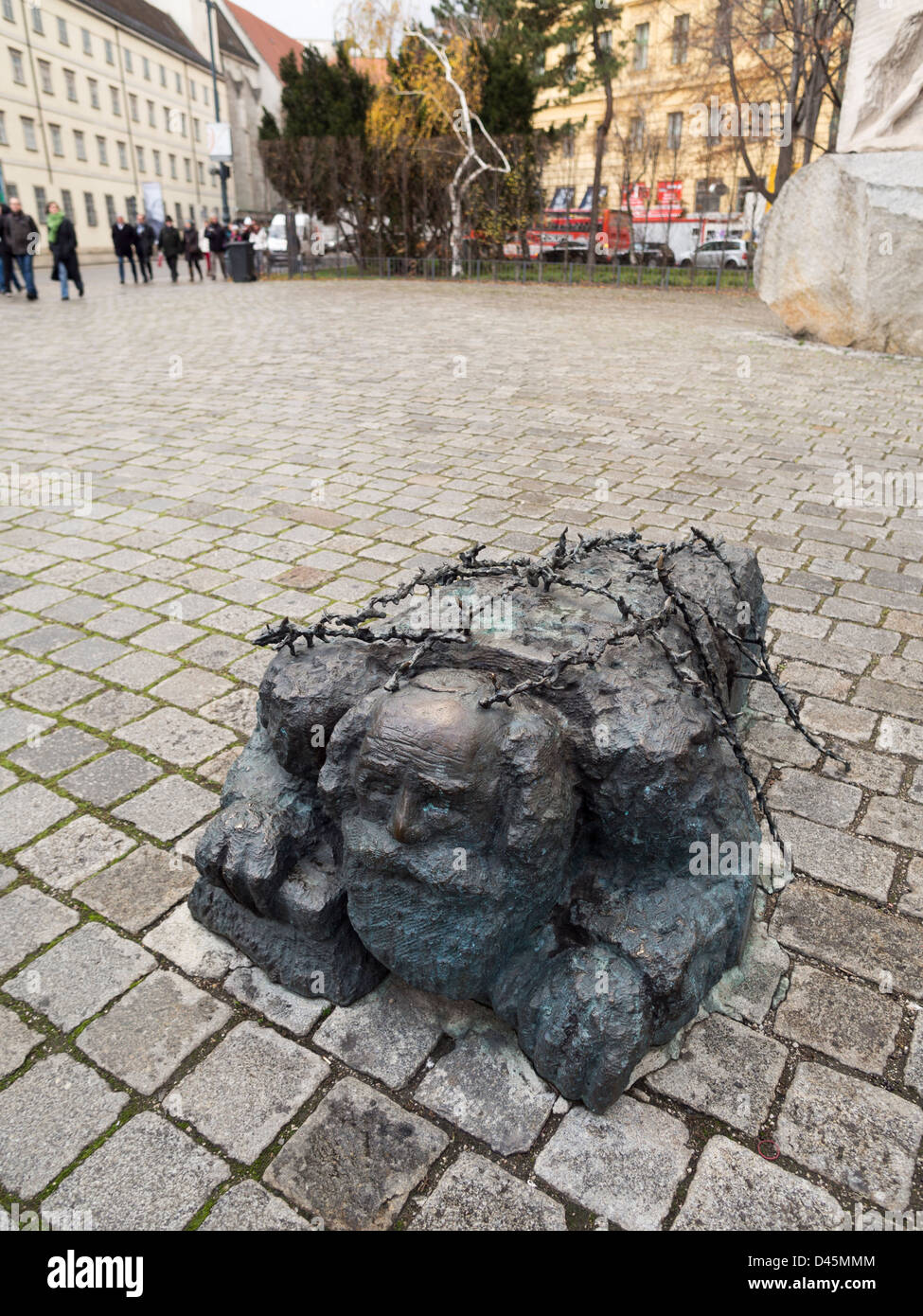 Scrubbing the Pavement detail. Sculpture of an old jewish man made to scrub the streets of Vienna with a hand brush. - Stock Image