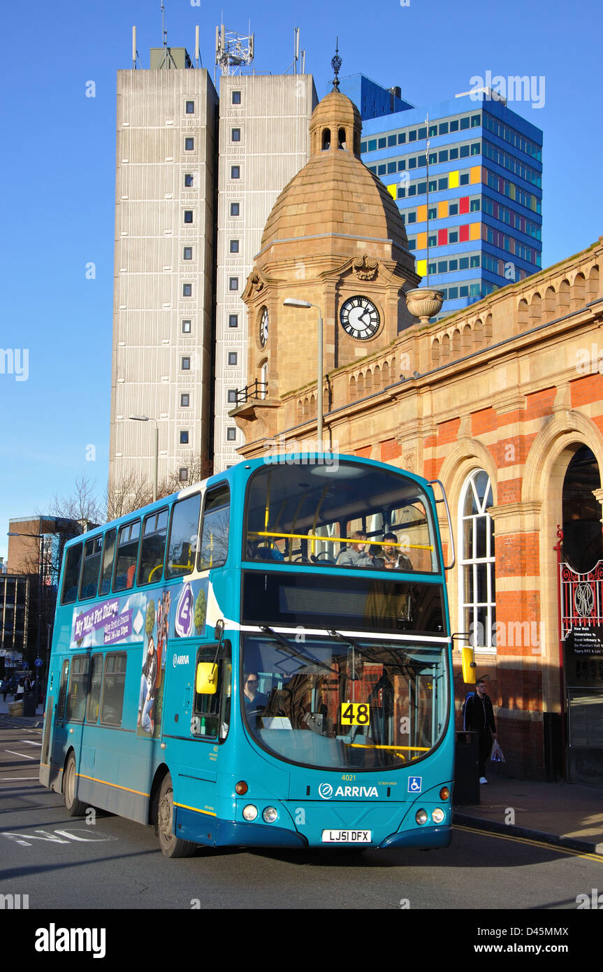 Arriva double decker bus travelling by entrance to Leicester station, England, UK - Stock Image