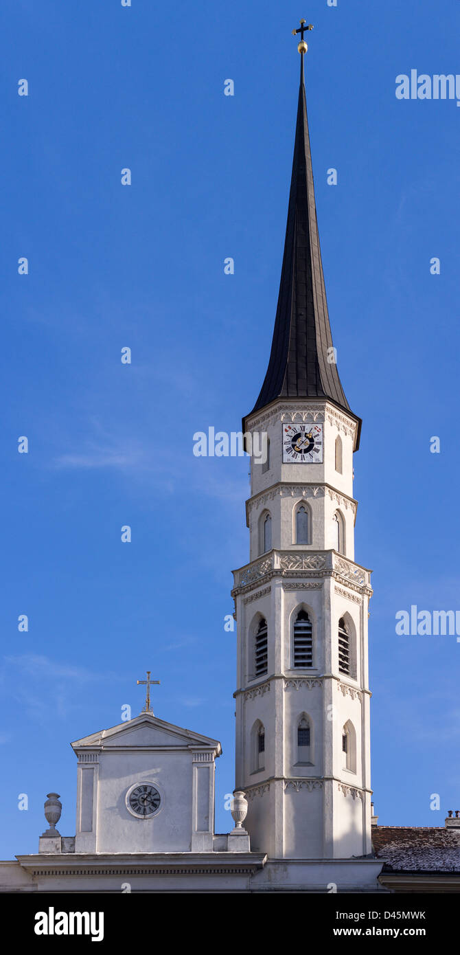 Tall Spire of the clocktower St. Michael's Church. Piercing a bright blue sky the tower sparkles in the sunshine. - Stock Image