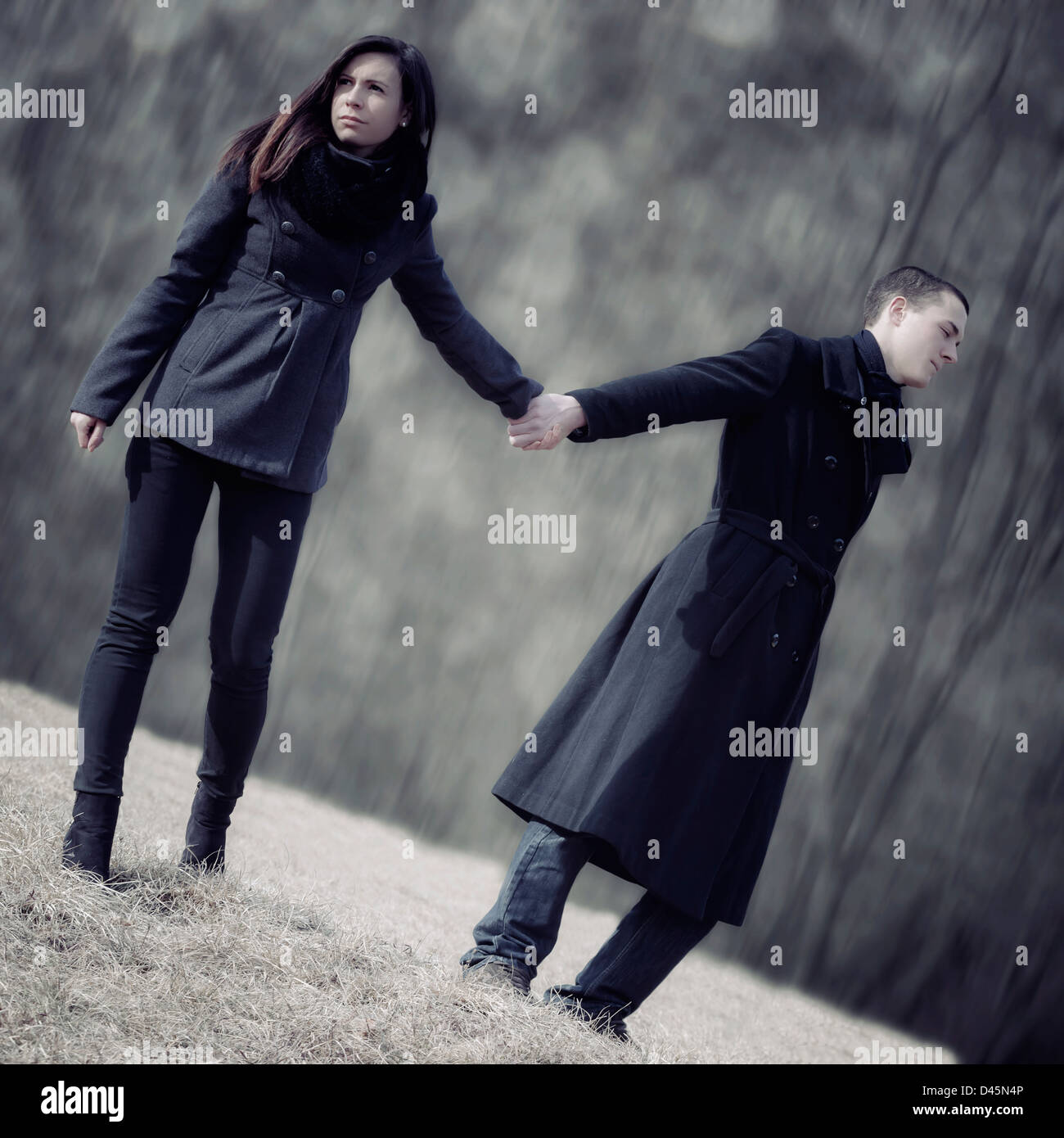 a man tries to hale his girlfriend, but she doesn't want - Stock Image