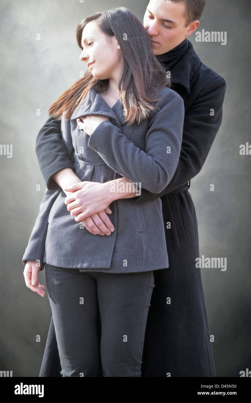 a man hugs his girlfriend - Stock Image