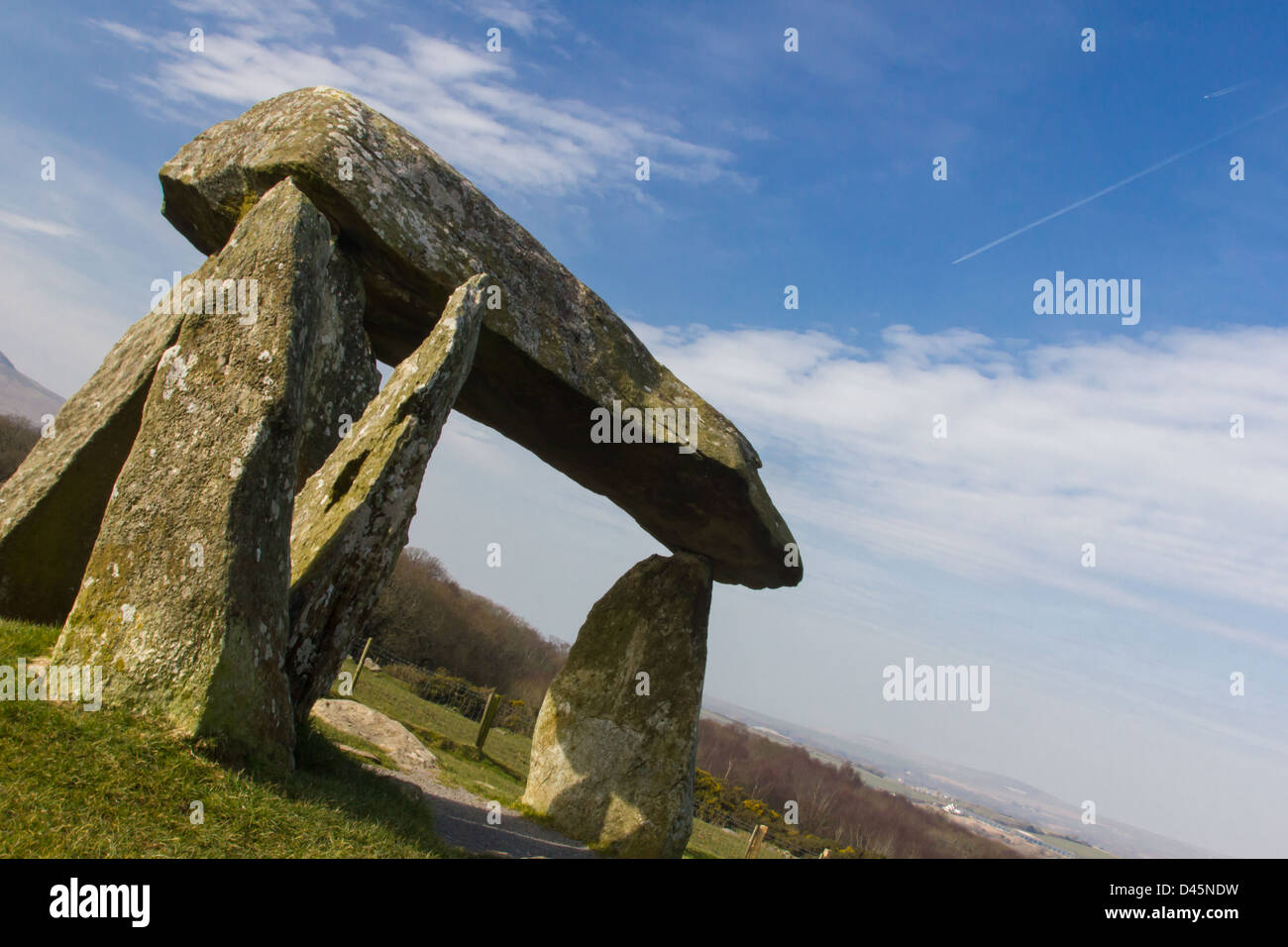 Pentre Ifan dolmen with airoplane trails in the sky. - Stock Image