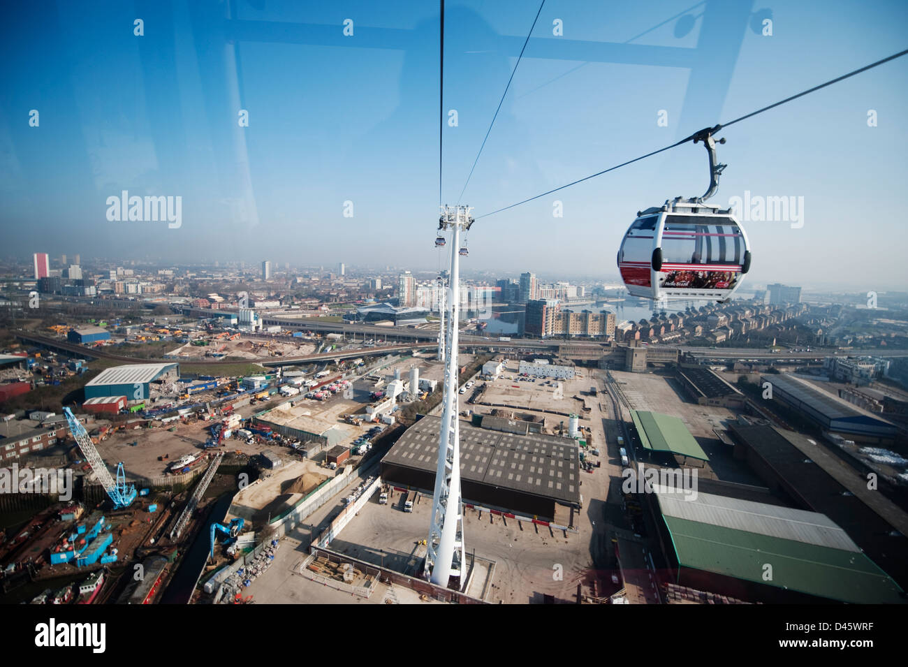 Aerial view north from the Emirates Air Line cablecar with Royal Victoria Docks in the distance, London, UK - Stock Image