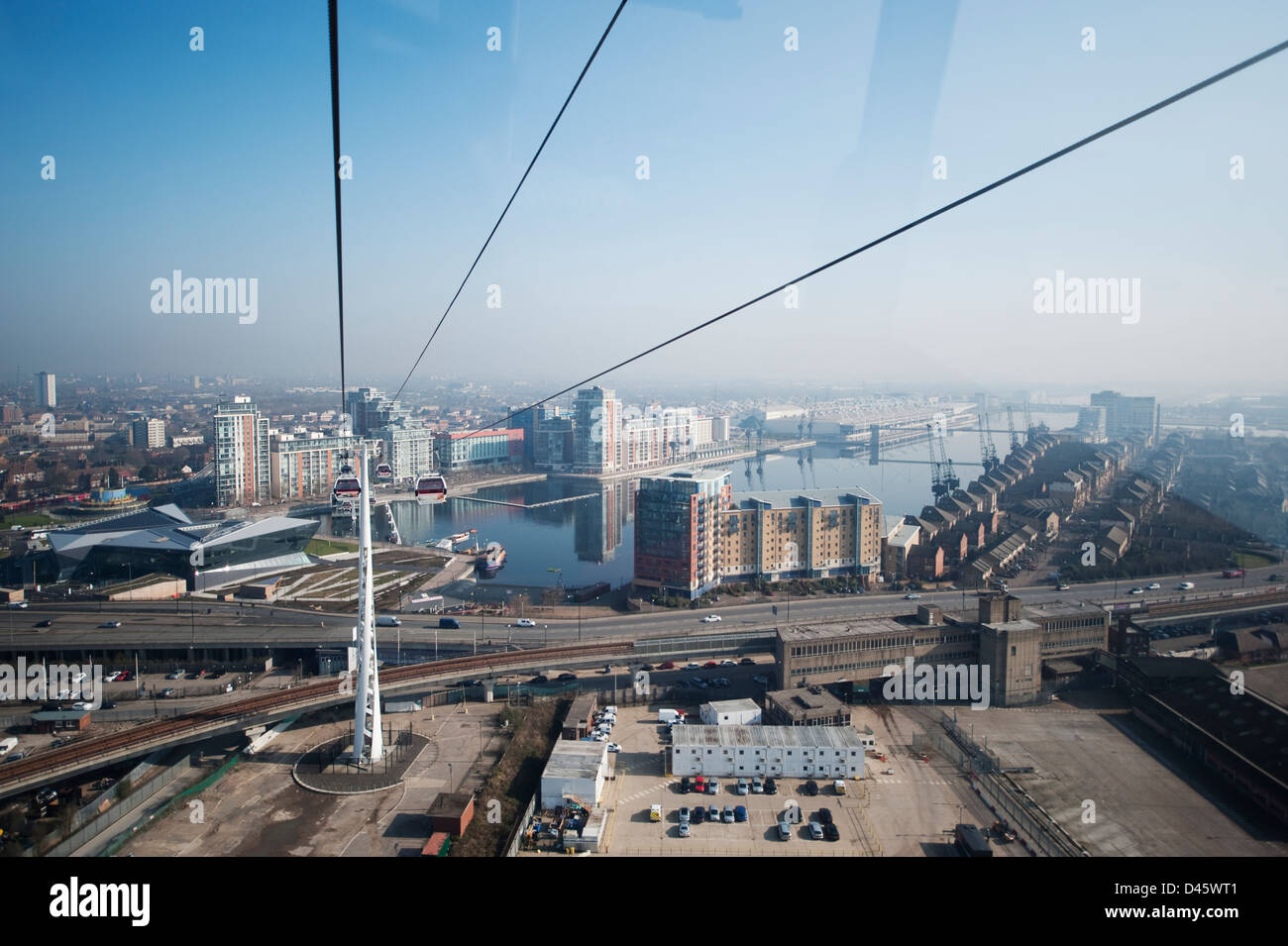 Aerial view north from the Emirates Air Line cablecar above the dlr tracks with Royal Victoria Docks in the distance, - Stock Image