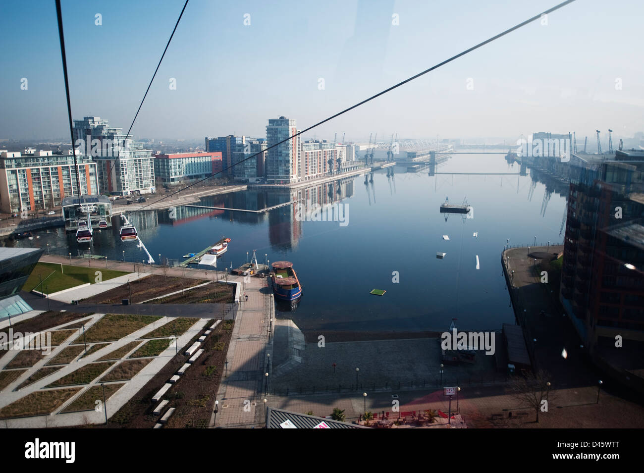 Aerial view north from the Emirates Air Line cablecar above the Royal Victoria Docks and ExCel in the distance, - Stock Image