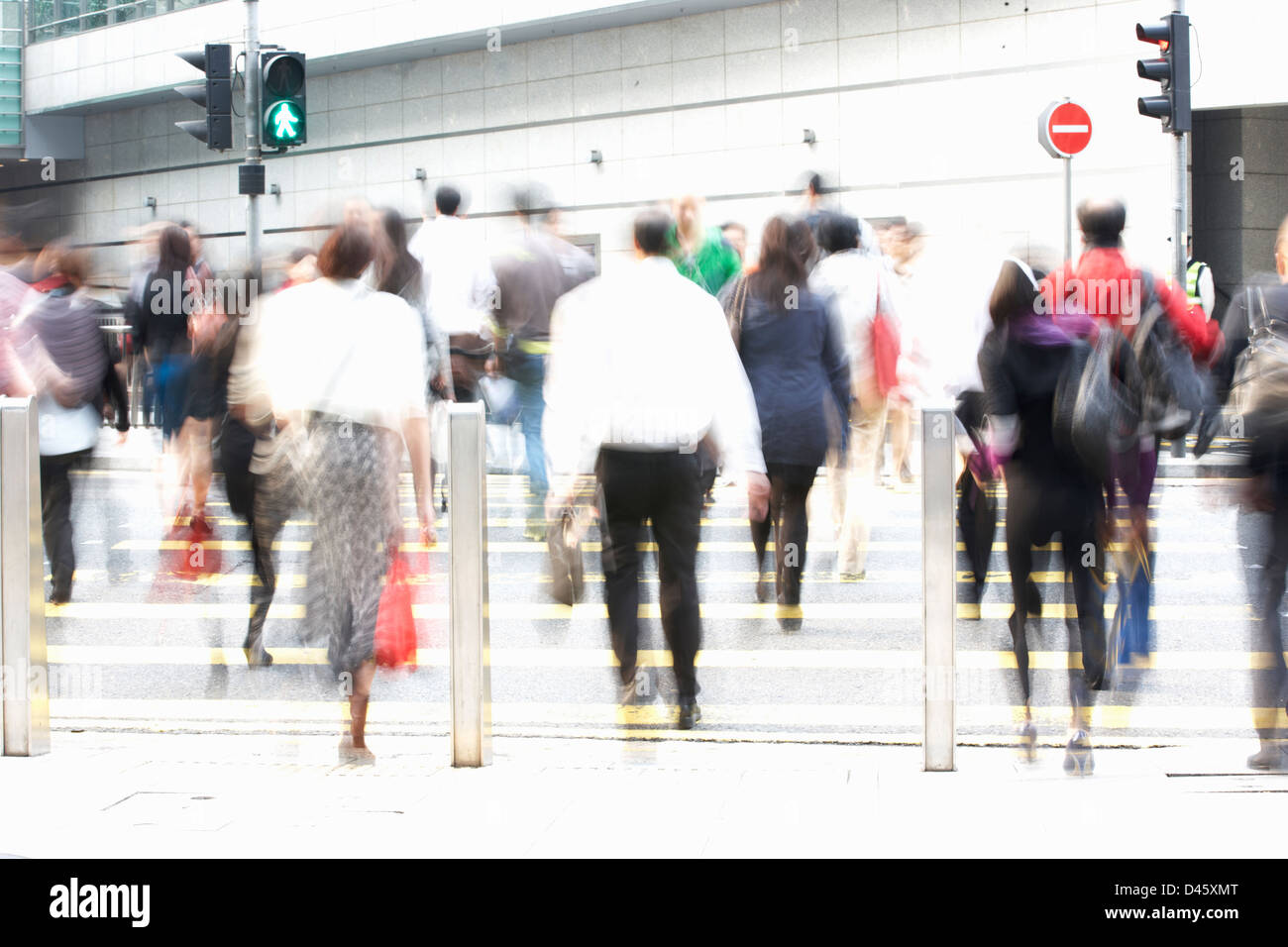 Commuters Crossing Busy Hong Kong Street - Stock Image
