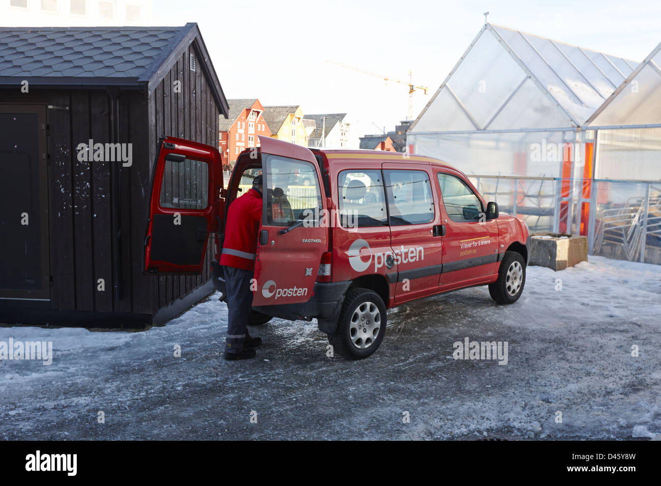 norwegian postman with delivery vehicle Tromso troms Norway europe - Stock Image